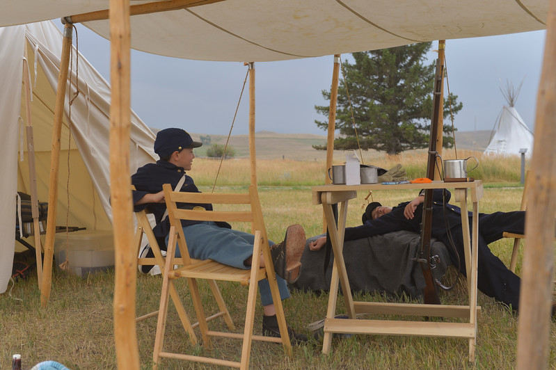 Justin Sheely | The Sheridan Press<br /> Eleven-year-old reenactor Nathian Holloway, left, and Cameron Holloway, 13, rest after a sleepless camping experience prior to the reenactment battle during the 150-year anniversary of the Wagon Box Fight Saturday at the Fort Phil Kearny State Historic Site. The battle involved 32 United States soldiers and nearly 800 warriors on Aug. 2, 1867 approximately 30 miles south of Sheridan. The soldiers held off the attacks of the Native warriors with only six casualties.