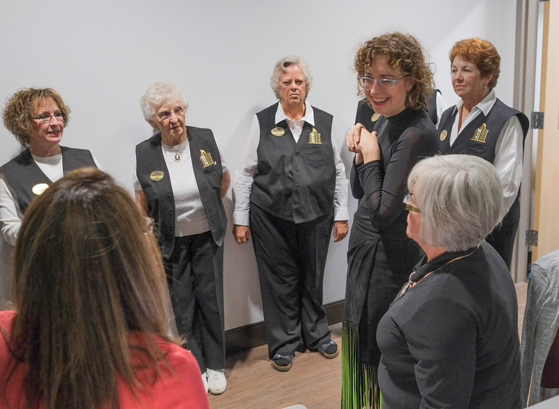 Justin Sheely | The Sheridan Press<br /> Director of the Whitney Center for the Arts Erin Hanke talks to the volunteer ushers from the WYO Theater during the reception for the inaugural concert Saturday night at the Whitney Center for the Arts Concert Hall.