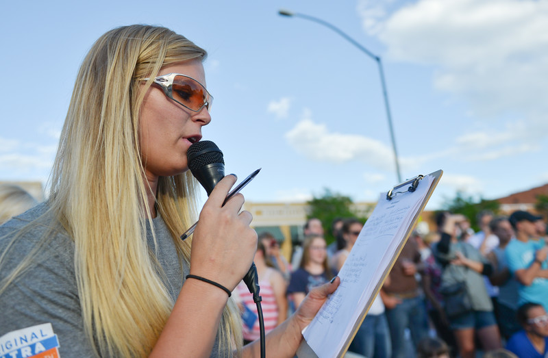 Justin Sheely | The Sheridan Press<br /> Kayla Corcoran announces results during the Wiener Dog Races Tuesday evening outside of Black Tooth Brewery. The event was hosted by Muddy Paw Prints.