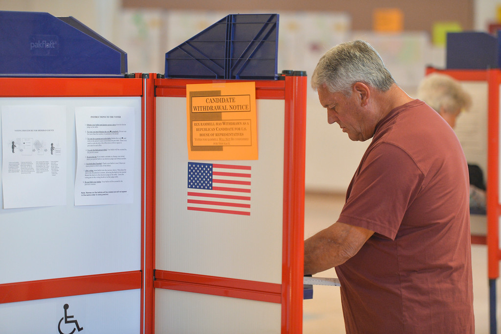 Justin Sheely | The Sheridan Press<br /> John Van Allen fills in his ballot at the polling station for the Wyoming Primary Election Tuesday at the Sheridan County Fairgrounds Exhibit Hall.