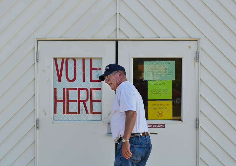 Justin Sheely | The Sheridan Press<br /> Tom Couch enters the polling station for Wyoming Primary Election Tuesday at the Sheridan County Fairgrounds Exhibit Hall.