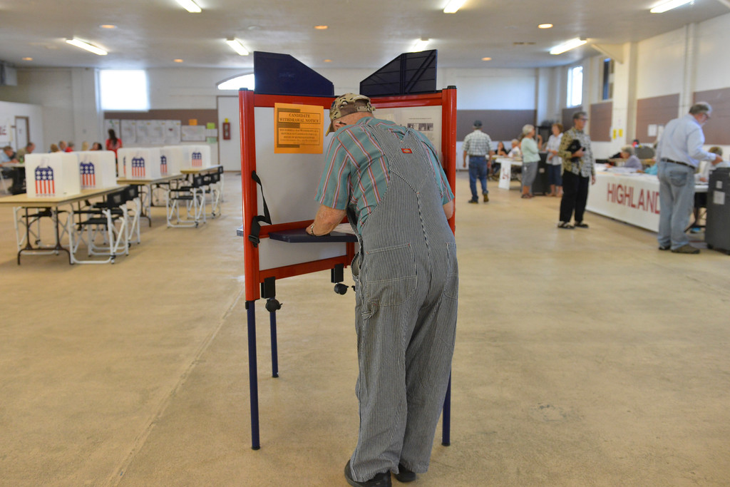 Justin Sheely | The Sheridan Press<br /> Erwin Doss votes during the Wyoming Primary Election Tuesday at the Sheridan County Fairgrounds Exhibit Hall.