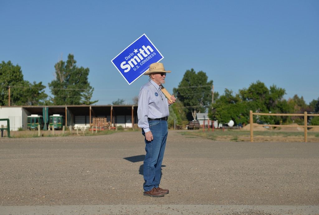 Justin Sheely | The Sheridan Press<br /> Darin Smith's Sheridan campaign manager Alfred Hill holds a sign at the fairgrounds during the Wyoming Primary Election Tuesday at the polling station at the Sheridan County Fairgrounds Exhibit Hall. Hill was later asked to move at least 100-yards from the doors of the polling station to comply with election rules.