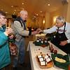 "Annual Armenian Food Festival at Saint Vartanantz Armenian Church. Beverly Kling and her husband Clyde ""Bill"" Kling of Tewksbury sample George Simonian's homemade jams. (SUN/Julia Malakie)"
