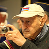 Annual commemoration of the Armenian Genocide, at Lowell City Hall. Stephen Dulgarian of Chelmsford photographs the ceremony. Both his parents were survivors of the Armenian Genocide. (SUN/Julia Malakie)