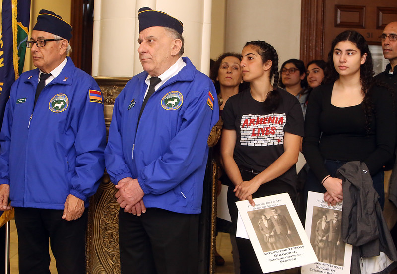 Annual commemoration of the Armenian Genocide, at Lowell City Hall. From left, Armenian American Veterans Rick Baumeister of Nashua, Armen Jeknavorian of Chelmsford, Tsoline Gevorkian, 16, of Bedford, and Araz Dulgarian, 17, of Bedford.(SUN/Julia Malakie)