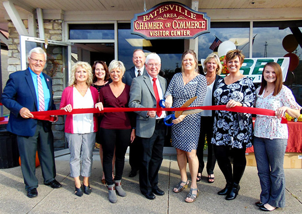 Executive director Tricia Miller (center with scissors) cuts the ribbon to officially open the Batesville Area Chamber of Commerce at its new Batesville Shopping Village location. With her are (front row from left) BACC ambassador Frank Thompson, marketing consultant Melissa Tucker and President Mary Huntington; Mayor Mike Bettice; BACC Past President Maggie Henson and office coordinator Halle Fischer; (back row) Batesville Main Street executive director Tina Longstreth; BACC board member Mark Graver; and Batesville economic development director Sarah Lamping.