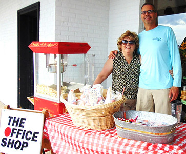 Office Shop employee Janicee Miller makes popcorn while husband Steve passes them out to attendees of the Batesville Main Street and Batesville Area Chamber of Commerce celebration at Batesville Shopping Village Oct. 10.