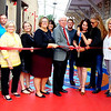 Batesville Main Street's first art alley activation was celebrated with a ribbon cutting ceremony Oct. 10. The alley is located at Batesville Shopping Village between Randy's Roadhouse and S&B Driving School. On hand were (front row from left) Batesville High School art teacher Andrea Grimsley; Indiana Office of Community and Rural Affairs community liaison Jennifer Voris, project manager Colette Childress and executive director Jodi Golden; Mayor Mike Bettice; Batesville Main Street executive director Tina Longstreth, alley benchmaker Chaz Kaiser; Batesville Main Street Design Committee member and event organizer Melissa Tucker, Batesville Main Street board member Anne Raver; (back row) BHS art teacher Kyle Hunteman, Batesville Main Street Design Committee chair Greg Wade, mayoral assistant Andrea Wade and community development director Steven Harmeyer.