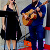 Shannon and Bryce Mullins entertain at the art alley activation at Batesville Shopping Village Oct. 10.