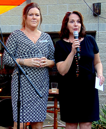 """Tricia Miller (left) and Tina Longstreth led a champagne toast to the art alley at the Randy's Roadhouse patio. Longstreth, the Batesville Main Street executive director, pointed out the fun evening was """"a great collaboration between the city, chamber and Main Street."""""""