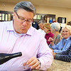 Sommelier Chris Nichols pours a sample of 2017 Silencer pinot noir at Batesville Liquor Co. during 5-7 p.m. wine tastings.