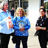 As people gathered for a fun evening Oct. 10 at Batesville Shopping Village, art teachers Mary K. Cambron (left) and Andrea Grimsley (right) chat with Debbie Mullins, whose son and daughter-in-law, Bryce and Shannon Mullins, were the first musicians to perform.