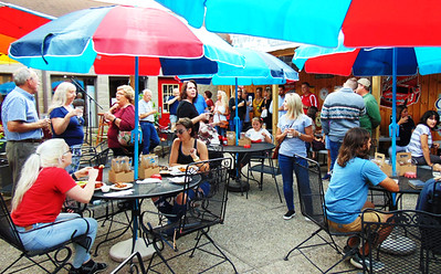 Event attendees gathered at the Randy's Roadhouse patio for food and drink specials after the two ribbon cuttings.
