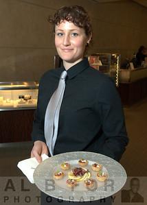 Ginger (Brulee Catering Food server) serving Proscultto wrapped Salsity