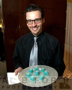 Christopher Stone (Brulee Catering Food server) serving Petits fours (is a small confectionery generally eaten at the end of a meal (e.g., with coffee) or served as part of dessert)