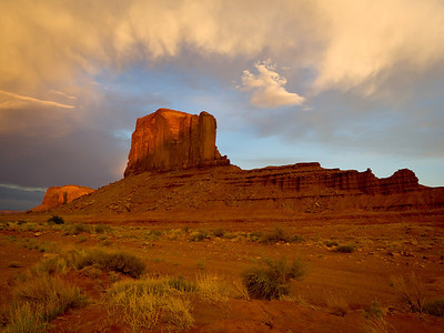 Clouds surround Monument Valley mesa at sunset