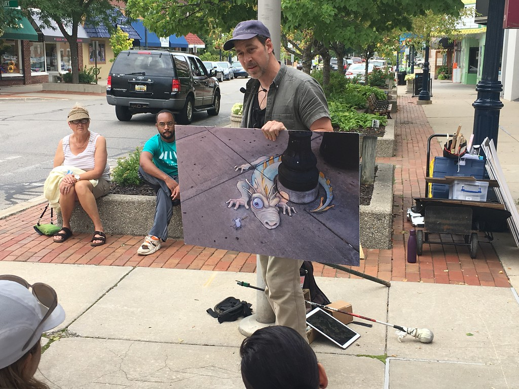 . Kullen Logsdon - The Morning Sun Commercial artist David Zinn teaches the steps to creating chalk art on Thursday, Aug. 10, on the sidewalk outside of Art Reach in Mt. Pleasant.