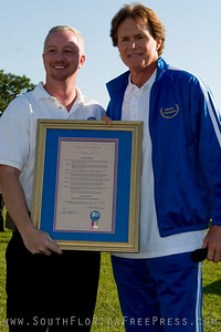 Mayor Jeff Clemmons of Lake Worth awards Bruce Jenner