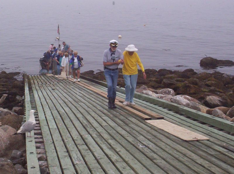 The Boat Ramp was mighty slick, see Darlene is not on it!  John is escorting the first artist onto the Island.