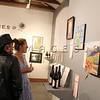 Guests enjoy the art at Arts D'Light held at The Petalma Arts Center on Saturday June 10, 2012.
