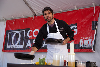 Nage Bistro Executive Chef Glenn Babcock cooks up a shrimp and strawberry risotto in the Cooking As Art Pavilion