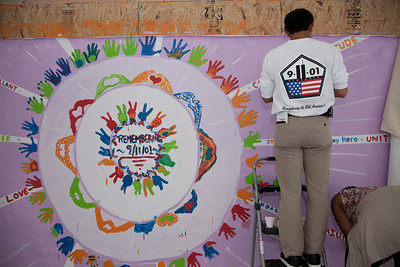 The Meta Experience hosted an interactive mural session. Visitors were invited to help paint two murals at the festival, one celebrating the arts in the nation's capitol, and this one commemorating peace during the 10th anniversary of September 11.