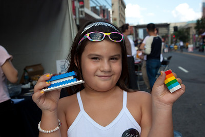 Azelle (age 7) of Greenbelt MD shows off her legos at the National Building Museum tent.