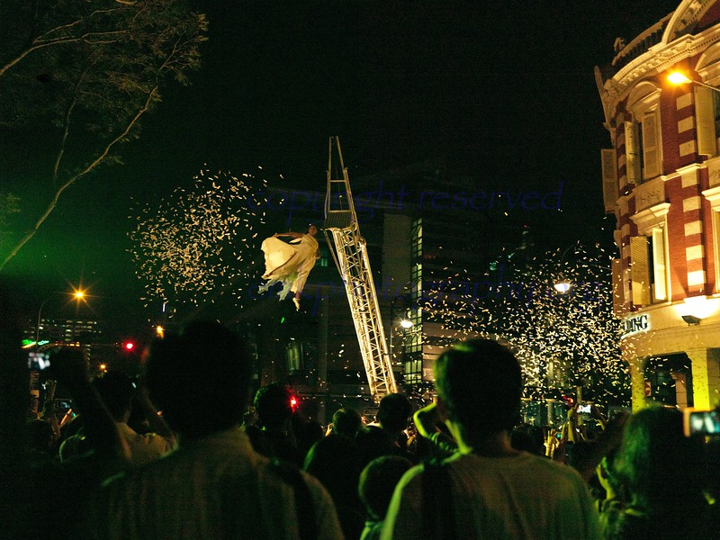 NIght Festival 2012<br /> Fuerzabruta - the Analog Girl amid a hail of confetti showered upon the crowds below.