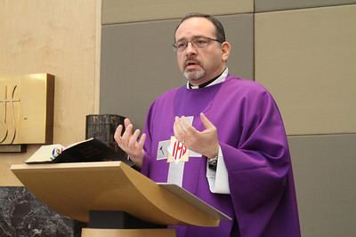 Father Miguel Grave de Peralta, director of pastoral care at St. Joseph's Hospital, Atlanta, gives his Ash Wednesday homily during the Feb. 13 Mass at the hospital's chapel.