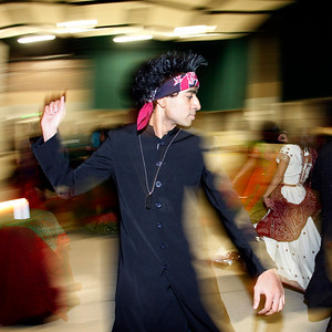 Health studies senior Nithin Natwa is frozen in time as he dances in a circle with other attendees of Asha for Education's Tarang 2009. Natwa and the others dancing in a circle were performing a Garba dance, a traditional dance from the Gujarat region of India.