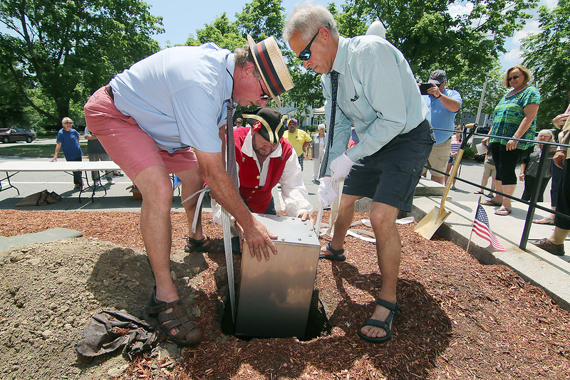 After the time capsule was filled an sealed it was put into the ground by 250th anniversary committee members Steve Coswell, George Cornwell Jr. and Bob Fichtel during the Ashburnham Town Hall ceremony on Saturday. SENTINEL & ENTERPRISE/JOHN LOVE