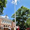 Raising the American flag during the Ashburnham time capsule is , from left, American Legion Service officer Joe Gaidanowicz with member of the Ashburnham Light Infantry Nathan Stiles, Jr. and George Cornwell Jr. SENTINEL & ENTERPRISE/JOHN LOVE