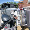 Gibby Lashua plays the accordion next to his 1930 model A car during the Ashburnham time capsule ceremony on Saturday. SENTINEL & ENTERPRISE/JOHN LOVE