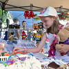 Lilly McEvoy, 8, of Lunenburg looks over some knitted stuff at Crochet Critters booth during the Inaugural Ashburnham Lion's Club Community Day on Saturday. SENTIENL & ENTERPRISE/JOHN LOVE