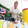 Angle May Lehtonen makes some fresh squeezed Lemonade at the booth for William J. Bresnahan Scouting & Community Center during the Inaugural Ashburnham Lion's Club Community Day on Saturday. SENTIENL & ENTERPRISE/JOHN LOVE
