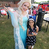 Elsa from the movie Frozen posed for a picture with Dhruti Patel, 7, at the AThol Savings Bak booth during the Inaugural Ashburnham Lion's Club Community Day on Saturday. SENTIENL & ENTERPRISE/JOHN LOVE