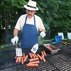 Joe Daigle cooks up some hotdogs at the booth for William J. Bresnahan Scouting & Community Center during the Inaugural Ashburnham Lion's Club Community Day on Saturday. SENTIENL & ENTERPRISE/JOHN LOVE