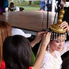 A Filipina gets a little help with her headdress before her performance.