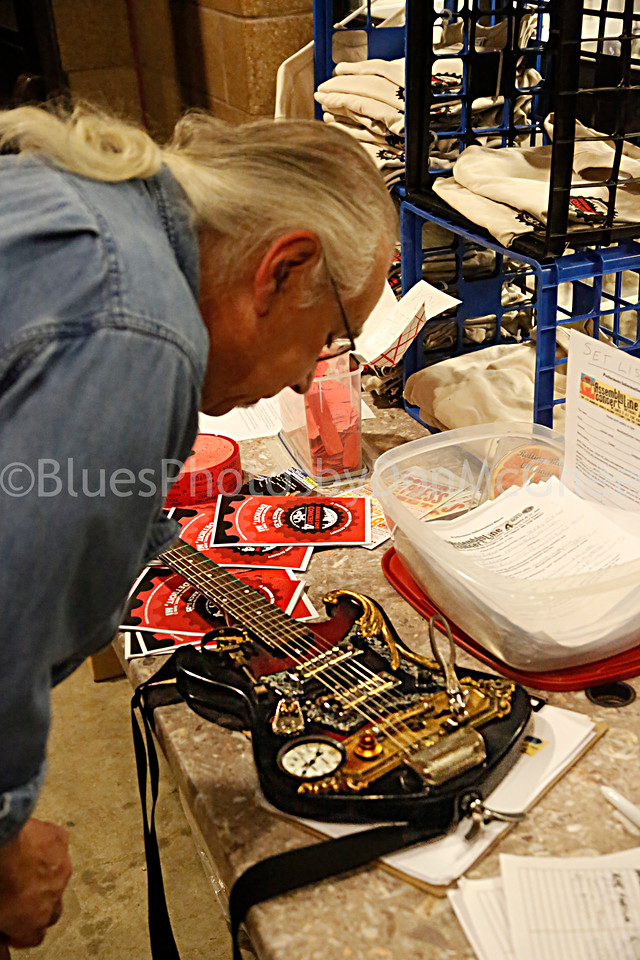 George Dubrish checks out custom guitar crafted by Steve Brook