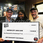 A J O'Neil presents a Community Cafe Grant to owners of the Motor City Java Cafe
