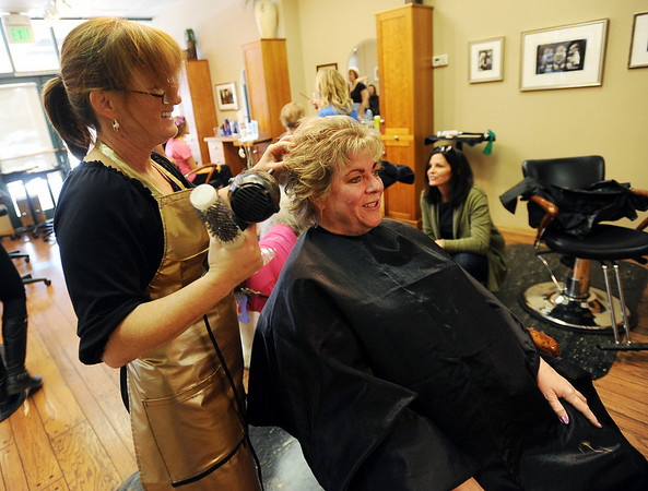 "Patrice Byrne gets her hair styled by Radine Dempsey. Proceeds form all the work done at Tapestry on Sunday will benefit the search for Aubrey Sacco.<br /> Tapestry Hair Salon of Boulder, held a fundraiser on Sunday for search efforts to find Aubrey Sacco,  a 23-year old CU graduate from Greeley, who is missing in Nepal.<br /> For more photos and a video of the event, go to  <a href=""http://www.dailycamera.com"">http://www.dailycamera.com</a>.<br /> Cliff Grassmick / November 14, 2010"