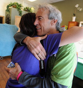 Paul Sacco, father of Aubrey Sacco, hugs Paula Tsiftilis, a friend of his daughter's. Tapestry Hair Salon of Boulder, held a fundraiser on Sunday for search efforts to find Aubrey Sacco,  a 23-year old CU graduate from Greeley, who is missing in Nepal. For more photos and a video of the event, go to www.dailycamera.com. Cliff Grassmick / November 14, 2010