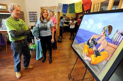 Paul Sacco, left, father of Aubrey Sacco, along with Laura Cornish, look at a painting of his missing daughter, made by  John Bukaty. Tapestry Hair Salon of Boulder, held a fundraiser on Sunday for search efforts to find Aubrey Sacco,  a 23-year old CU graduate from Greeley, who is missing in Nepal. For more photos and a video of the event, go to www.dailycamera.com. Cliff Grassmick / November 14, 2010