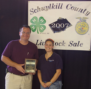 Bob Greene, Pioneer Pole Buildings recipient of 2007 4H/FFA Buyers Award with Briana Shealer, Youth Development/4-H Educator