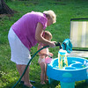 Eve and Grannie playing with the water table