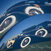 A reflection - all off of a fender skirt and body of an amazing vehicle.