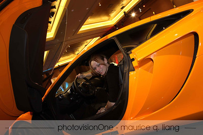 Hana checks out the McLaren.