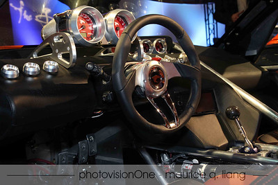 Interior of Falcon F7.  Note the mechanical look of the gauges, shifter, and pedals.