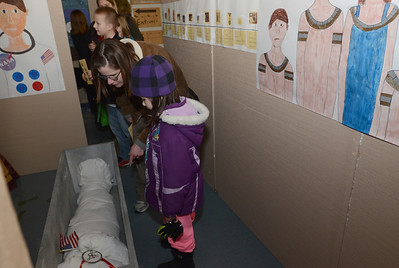 Erica Benson—ebenson@shawmedia.com  Heidi Engel and her daughter Maya take a closer look at the mummification of Neil Armstrong at the mastaba exhibit hosted by 5th graders of Avery Coonley School Thursday Feb. 21 2013.